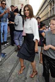 Carine Roitfeld went to the Salvatore Ferragamo fashion show wearing chic tan sandals with a pencil skirt and a crop-top.