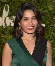 Freida Pinto styled her hair with vintage-chic waves for the Salvatore Ferragamo celebration of 100 years in Hollywood.