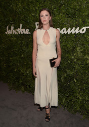 Ireland Baldwin put on a daring display at the Salvatore Ferragamo celebration of 100 years in Hollywood in this nude dress from the label, featuring a cleavage-baring keyhole cutout and sheer panels on the skirt.