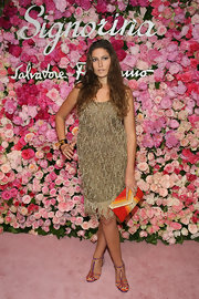 Stella Schnabel carried a hot purse at the launch party of Signorina fragrance by Ferragamo.
