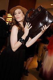 Elettra Wiedemann proudly showed off her brown crocodile tote during the Salvatore Ferragamo W bag launch.