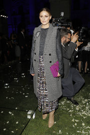 Olivia Palermo gave her grays a splash of color with a purple chain-strap bag by Ferragamo.