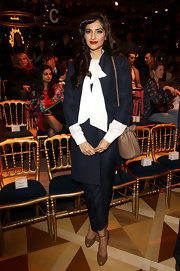 Sonam Kapoor stuck to the classics with her tan pumps and blue pantsuit combo at the Salvatore Ferragamo fashion show.
