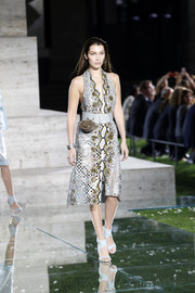 Bella Hadid was wild and chic in a laser-cut python halter dress at the Ferragamo runway show.