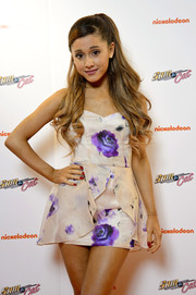 Ariana Grande looked super cute and sweet in a floral mini dress with peplum detailing during the premiere of 'Sam & Cat.'