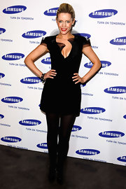 Sophia made an apperance in a tulle embellished black dress, which she paired with black tights and heels.