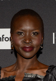 Alek Wek made her pout pop with lots of lipgloss.