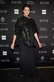 Linda Evangelista layered a loose black sheer-panel blouse over a column dress for the Harper's Bazaar Icons event.