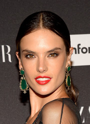 Alessandra Ambrosio glammed it up with a massive pair of dangling gemstone earrings.