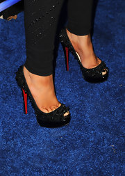 Christina Aguilera isn't afraid of some spikes and studs—hence these beyond incredible Louboutin peep-toes!