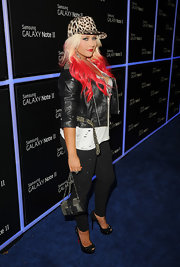 Christina Aguilera matched her edgy look with a studded and bowed evening bag.