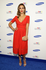 Jessica Alba complemented her gorgeous dress with a pair of silver strappy sandals by Brian Atwood.