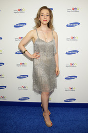 Sarah Hughes brought a Gatsby vibe to the Hope for Children Gala with this fringed silver dress.