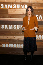 Rose Byrne brought a dose of sex appeal to the 'Adult Beginners' cocktail party with this rust-colored blazer which she wore sans shirt underneath.