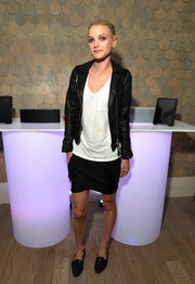 Jessica Stam attended the Samsung Shape Summer Mix Series wearing a black leather jacket over a white V-neck tee.