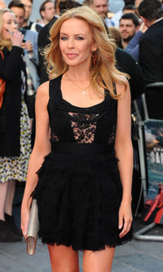 Kylie Minogue was fun and flirty at the 'San Andreas' UK premiere in a little black dress with a lace-panel bodice and a ruffle skirt.