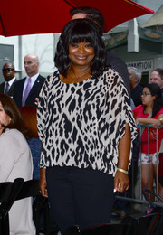 Octavia Spencer attended Sandra Bullock's hand and footprint ceremony looking breezy in a black-and-white print blouse.