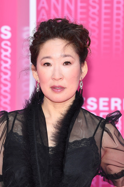 Sandra Oh Messy Updo [killing eve,hair,hairstyle,skin,beauty,pink,black hair,lip,forehead,makeover,long hair,pink carpet arrivals,sandra oh,when heroes fly,serie,cannes,france,1st cannes international series festival,palais des festivals,screening]