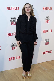 Drew Barrymore kept it smart and classic in a black ruffle button-down at the 'Santa Clarita Diet' photocall in Madrid.