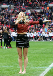 Pixie Lott performed at the Aviva Premiership wearing a red cropped jacket with black ruffle cuffs.