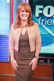 Sarah Ferguson made great hue choices by layering brown dress with a nude cropped jacket.