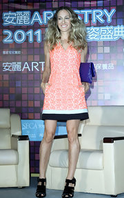 Sarah Jessica Parker hit a high note during a press conference in Taipei in a pair of black velvet gladiator style sandals. The heavy footwear added visual interest to Sarah's coral shift.
