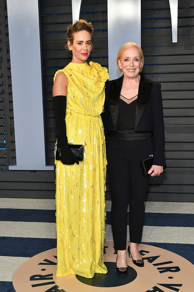 Sarah Paulson Hard Case Clutch [oscar party,vanity fair,l,yellow,fashion,clothing,fashion design,haute couture,fashion model,dress,event,outerwear,flooring,beverly hills,california,wallis annenberg center for the performing arts,radhika jones - arrivals,sarah paulson,radhika jones,holland taylor]