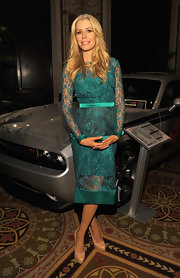 Aviva Drescher looked stunning in her green lacy dress at the Sarah Reinertsen product launch.