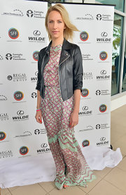 Mickey Sumner paired a classic leather jacket over her printed maxi for a cool blend of edgy and bohemian styles.