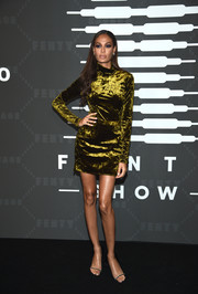 Joan Smalls attended the Savage X Fenty show wearing an olive-green velvet dress.