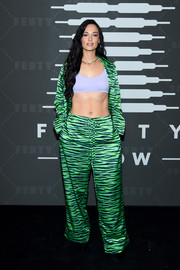 Kacey Musgraves rocked green tiger-print pajamas at the Savage X Fenty show.