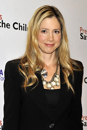 Mira Sorvino wore her hair in flowy waves for the Save the Children press conference.
