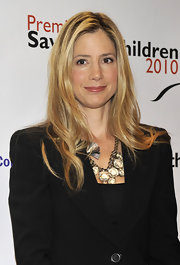 Mira Sorvino added some flair to her subdued outfit with a chunky crystal statement necklace.
