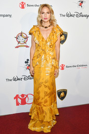 Rachel Zoe was boho-glam in a ruffled marigold jacquard gown from her own label during Save the Children's Centennial Celebration.