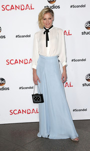 Portia de Rossi topped off her cute ensemble with a pearl-embellished box clutch.