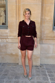 Alice Eve kept it relaxed yet stylish in a diamond-patterned maroon cardigan during the Schiaparelli Couture fashion show.