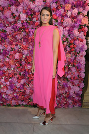 Mandy Moore styled her dress with cute heart-embellished pumps by Schiaparelli.