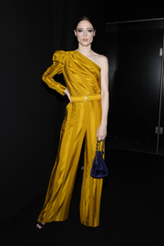 Coco Rocha added an extra pop of color with an indigo velvet pouch.