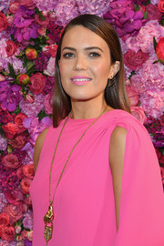Mandy Moore sported a chic hand-and-padlock pendant by Schiaparelli during the label's Couture Fall 2018 show.