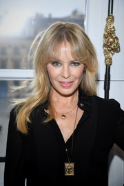Kylie Minogue sported a subtly wavy hairstyle with flippy bangs at the Schiaparelli Couture show.