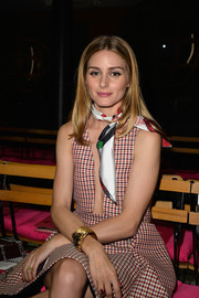 Olivia Palermo sat front row at the Schiaparelli Couture fashion show wearing an eye-catching gold cuff bracelet.