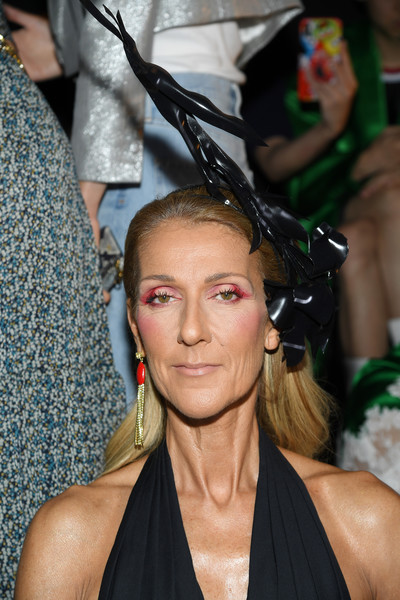Celine Dion topped off her flamboyant look with a sculptural black headpiece.