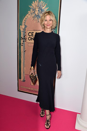 Meg Ryan styled her dress with sexy black cage heels.