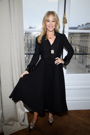 Kylie Minogue was classic and conservative in a long-sleeve black shirtdress at the Schiaparelli Couture show.