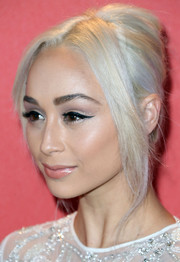 Cara Santana's french twist had loose strands of bangs in the front for a polished-yet-messy appearance