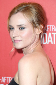 Diane Kruger wore a sleek cat eye to match her polished updo for a retro glam inspired look