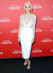 Cara Santana looked elegant in this long-sleeved midi ivory dress with sheer detailing and beaded designs.