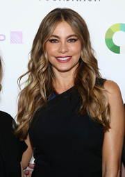 Sofia Vergara wore her tresses down in boho-glam waves during the SAG Golf Classic.