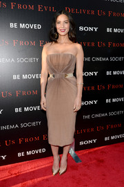 Olivia Munn looked simply divine in a nude strapless dress by Vionnet during the screening of 'Deliver Us from Evil.'