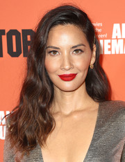 Olivia Munn added a fabulous splash of color with a swipe of matte red lipstick.